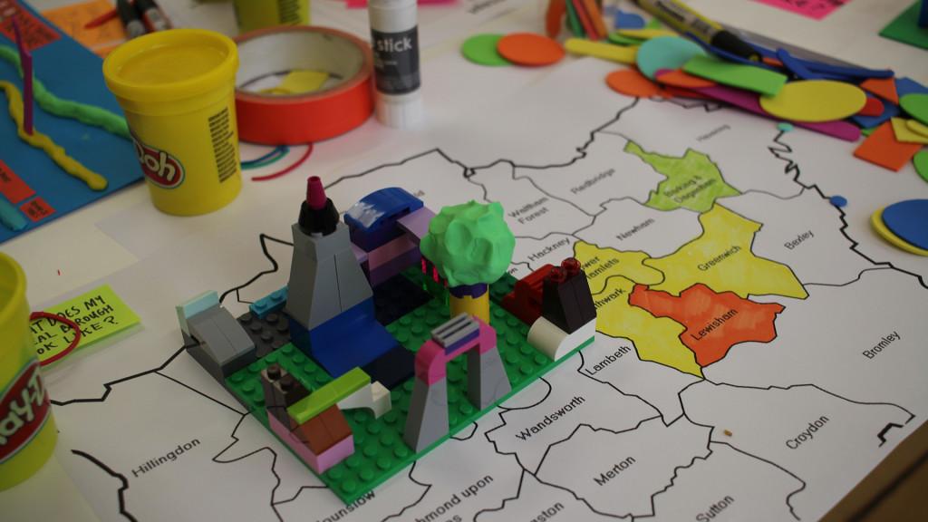 Playdoh, Lego blocks, tape laying on simple map
