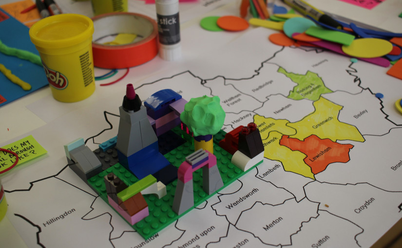 Playdoh, Lego blocks, tape laying on simple map