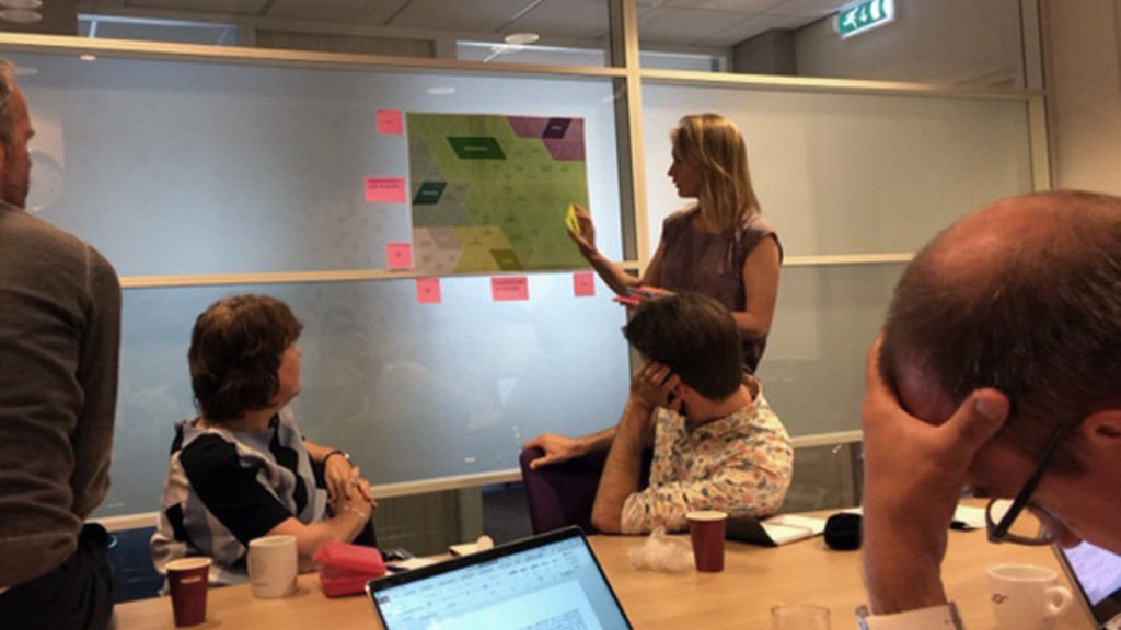 Woman presenting chart with post-it notes around it