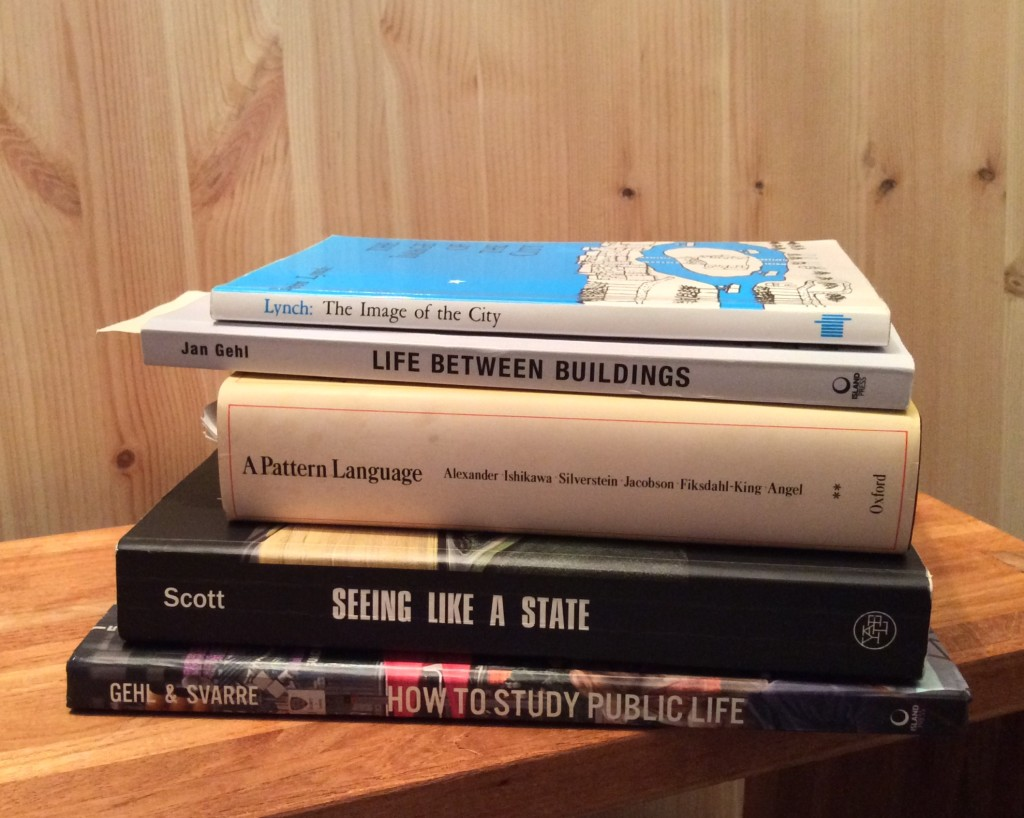 pile of five books about studying public life